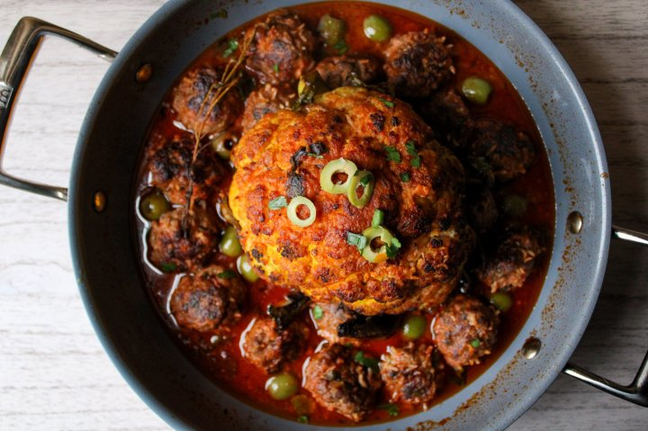 braised whole cauliflower with olives and syrianmeatballs